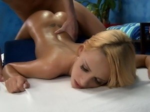Softly penetrating Erica on massage bed