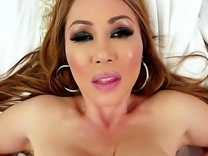 Kianna Dior is an Asian that is blessed with huge tits. They are big and firm...
