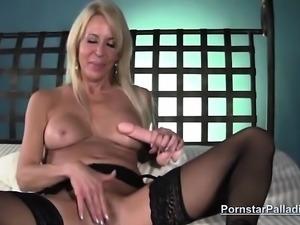 Erica Lauren tittyfucks a sex toy