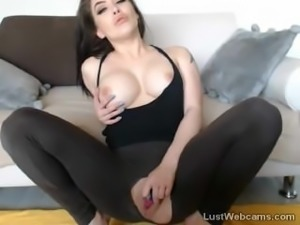 Busty brunette hottie masturbates with dildo on cam