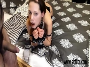 Brutally fisting his girlfriend in bondage