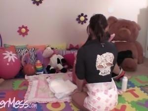 Nikki and Morgan put diapers