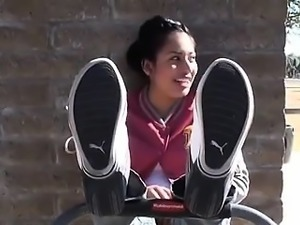 Beautiful foot fetishist putting her soles on display in th