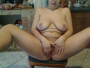 Amateur voluptuous white lady sits on the chair of webcam