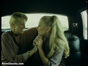 Blonde lesbians get busy eating pussy in the back seat of a car