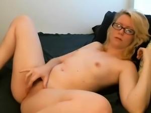Sporting eyeglasses that are sexyblonde masturbates titties