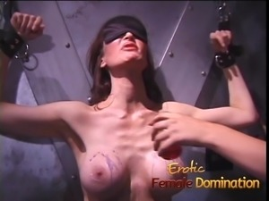 Pamela's big fake round tits are showered with hot wax