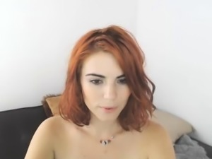 Sexy slender redhead camgirl takes her favorite sex toys fo