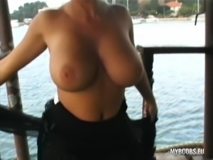 Curvy girls Aneta and Kora show off their huge breasts on an old boat