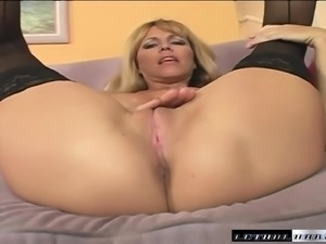 Busty Nicole Moore is on the prowl for a younger guy with a big stick
