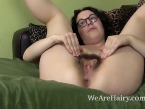 Tamar is 26, and sitting alone on her green chair. She strips naked and lays...