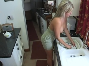 Downblouse Housewife washes dishes