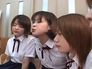 Four Japanese school girls spitting on teacher