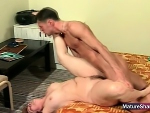 Mature giving mouth to young cock