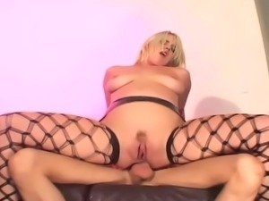 Blonde fucked on a couch in latex