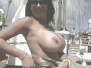 Sexy babe plays with herself on a yacht