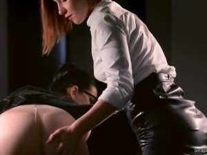 BRUNETTE GLASSES WEARING LESBIAN FUCKS REDHEAD HARD WITH STRAP-ON