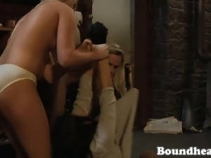Beautiful Mistress feeds lesbian slave on the floor