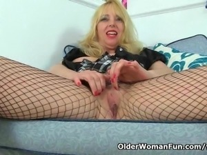 British milf Lucy Gresty masturbates in fishnet pantyhose