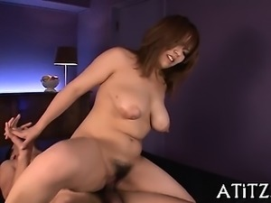 Asian strokes her own boobs before giving oral stimulation