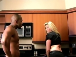 Busty blonde MILF takes on two black dicks and gets filled with them