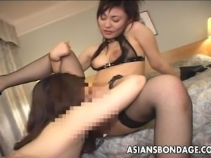 Roped up Asian slut eating out a wet muff