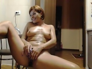 Ravishing redhead with a heavenly ass pleases her holes on