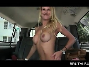 Playful blonde flashing hot boobs in sex bus
