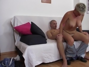 Grandma closes her eyes feeling the pleasure while riding on a stiff cock in...