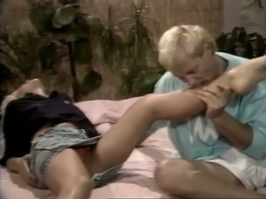 Good husband massages wife's feet and licks pussy