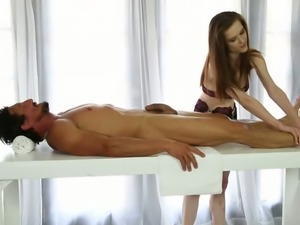 Pretty looking brunette GF sucks thick cock of older man in massage parlor