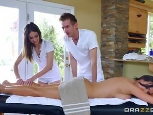 Flamboyant pair of masseurs give their customer a threesome treatment