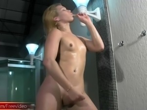 Horny shemale with a hot ass stroking her cock on the pool