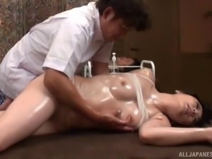 Beautiful Asian dame enjoying her natural tits being oiled