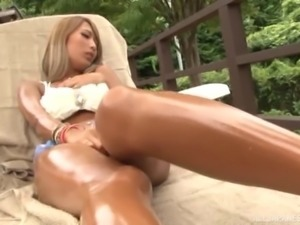 Asian damsel moaning as her juicy pussy gets banged in a threesome outdoor