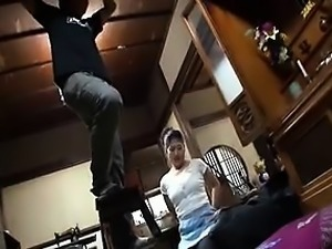 Lovely Asian maid with a luscious ass sits on the floor bef