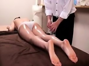 Beautiful Asian girl lies on her belly and enjoys a wonderf