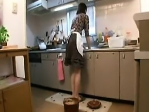 Horny Asian housewife with big tits pleases herself with a