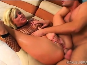 Wild blonde flaunts her curves and buries a long stick inside her ass