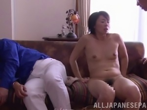 Bored Japanese wife fucks another guy as her hubby sleeps