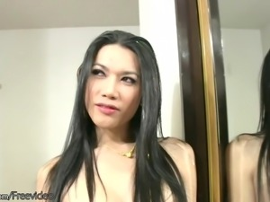 Imposing dark-haired shemale is very proud of her large erection