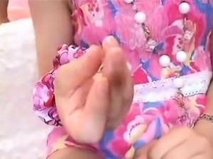 Petite Japanese girl in white panties wraps her hands aroun