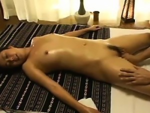 Masseuse is giving her a rubdown and gets all of her clothe