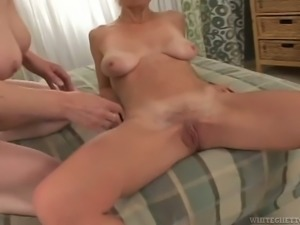 This horny old lady is having some naughty fun in the bedroom