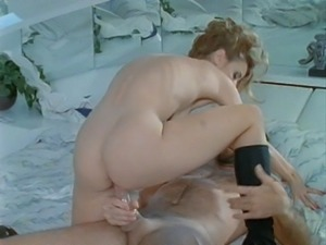 Lovely blonde with big naturals Christy Canyon has her butt creamed