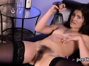 Breathtaking cutie is pissing and rubbing trimmed muff