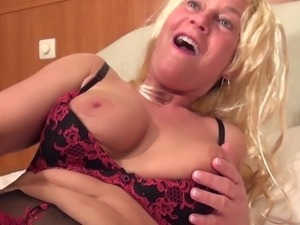 Raunchy grandma wearing a wig rams her meat hole with a toy