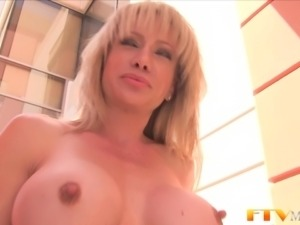 Milf shows massive clit