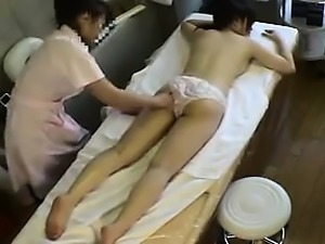 Bodacious Asian babe has a masseuse oiling up and caressing