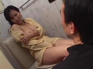 Elegant Japanese milf masturbating on the toilet and sucking dick